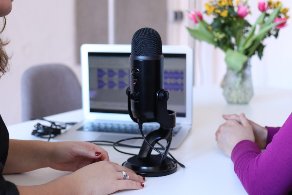 Two women recording a podcast together